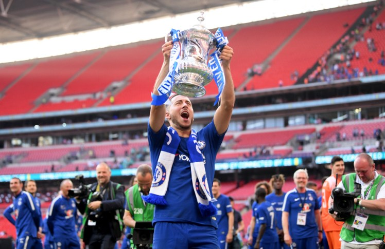 LONDON, ENGLAND - MAY 19: Eden Hazard of Chelsea celebrates with the Emirates FA Cup Trophy following his sides victory in The Emirates FA Cup Final between Chelsea and Manchester United at Wembley Stadium on May 19, 2018 in London, England. (Photo by Laurence Griffiths/Getty Images)