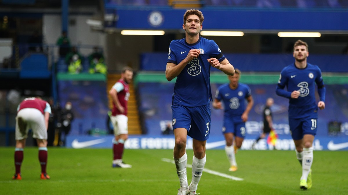 Marcos Alonso pointing to the Chelsea badge celebrating his goal against Burnley. Will he be in your team for Gameweek 23?
