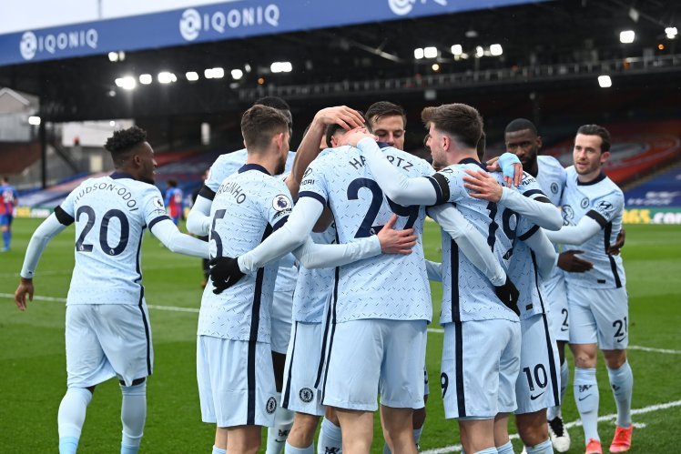 The squad celebrate their second goal.