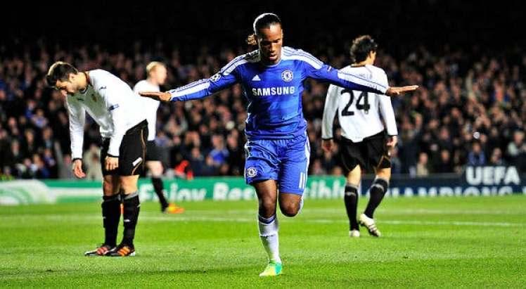 Didier Drogba celebrates scoring his 2nd goal against Valencia.
