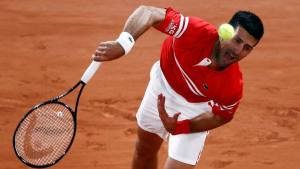French Open: Novak Djokovic saunters into round two with comfortable win