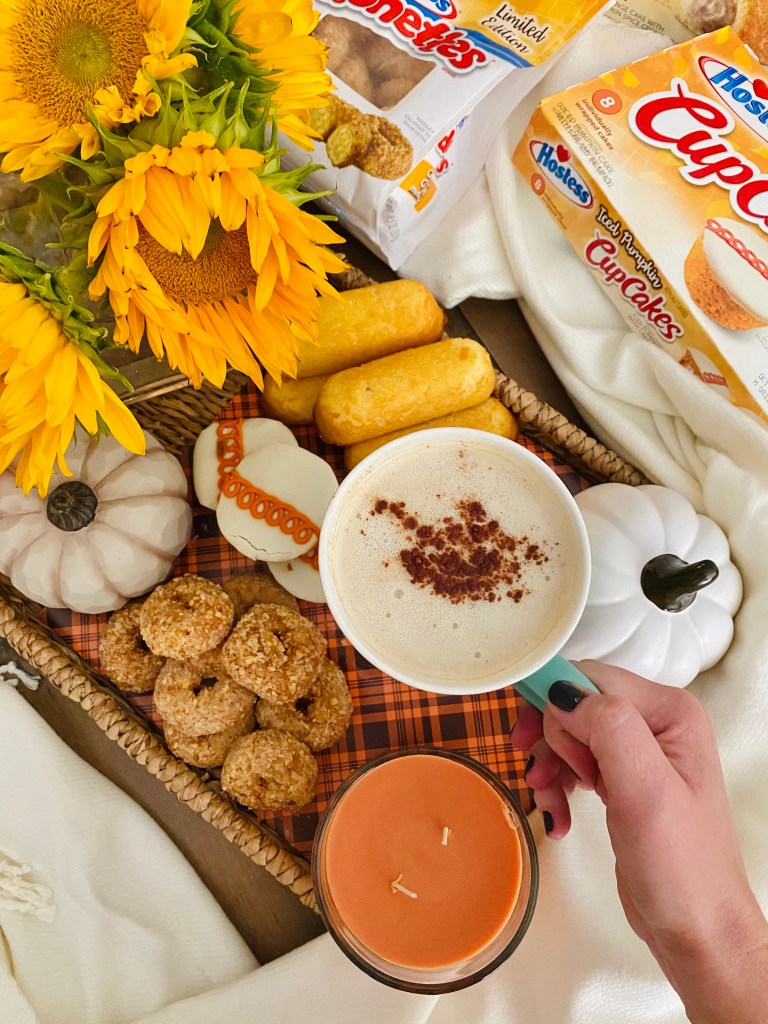 Pumpkin spice coffee with a fall snack board
