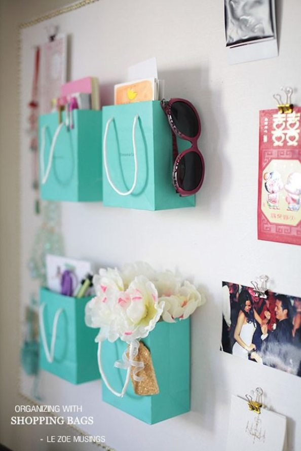 Clever Storage Uses for Repurposed Items :: Create pretty office organization with your favorite shopping bags like these pretty Tiffany's bags!