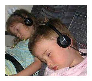 Children sound asleep in the car