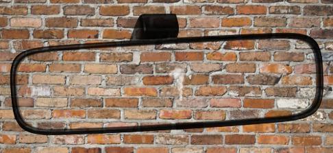 brickwall in rearview mirror