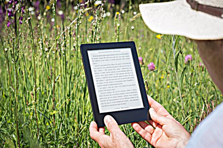 photo of hands holding kindle reader