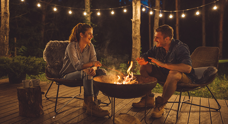 Couple talking while grilling