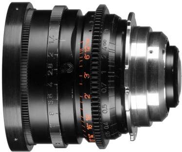 Here we can see an after-market delrin focus gear. It's thin design allow both metric and imperial marks to remain visible. Note another common customization, the metric engravings have been blacked out - most likely because they're simply not useful to the operator who is pulling focus off the imperial marks. This lens also has an add-on PL mount adapter as well as an upgraded 80mm front that partially covers the front knurling.