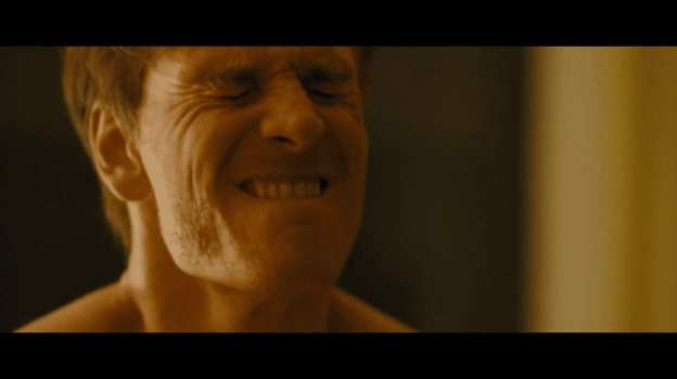 Michael Fassbender making o-face in the movie Shame