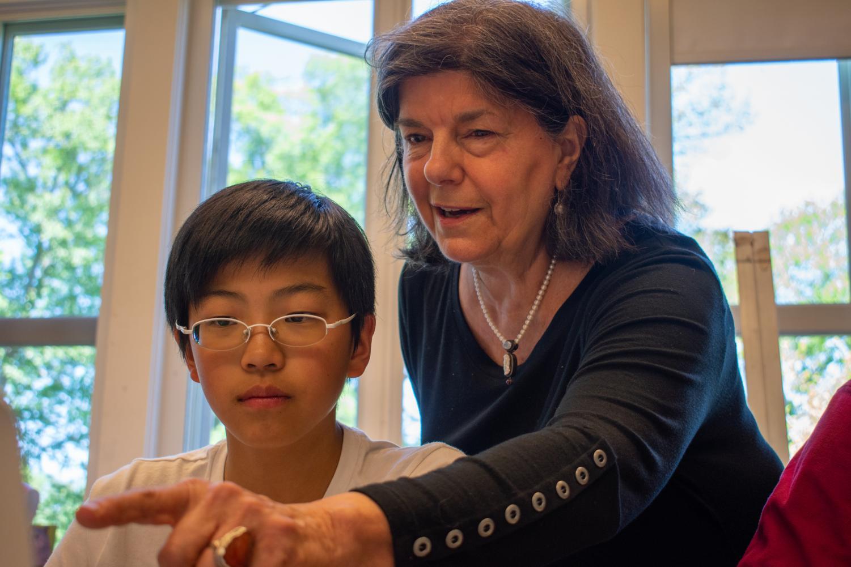 Ms. Van Gelder works with a student.