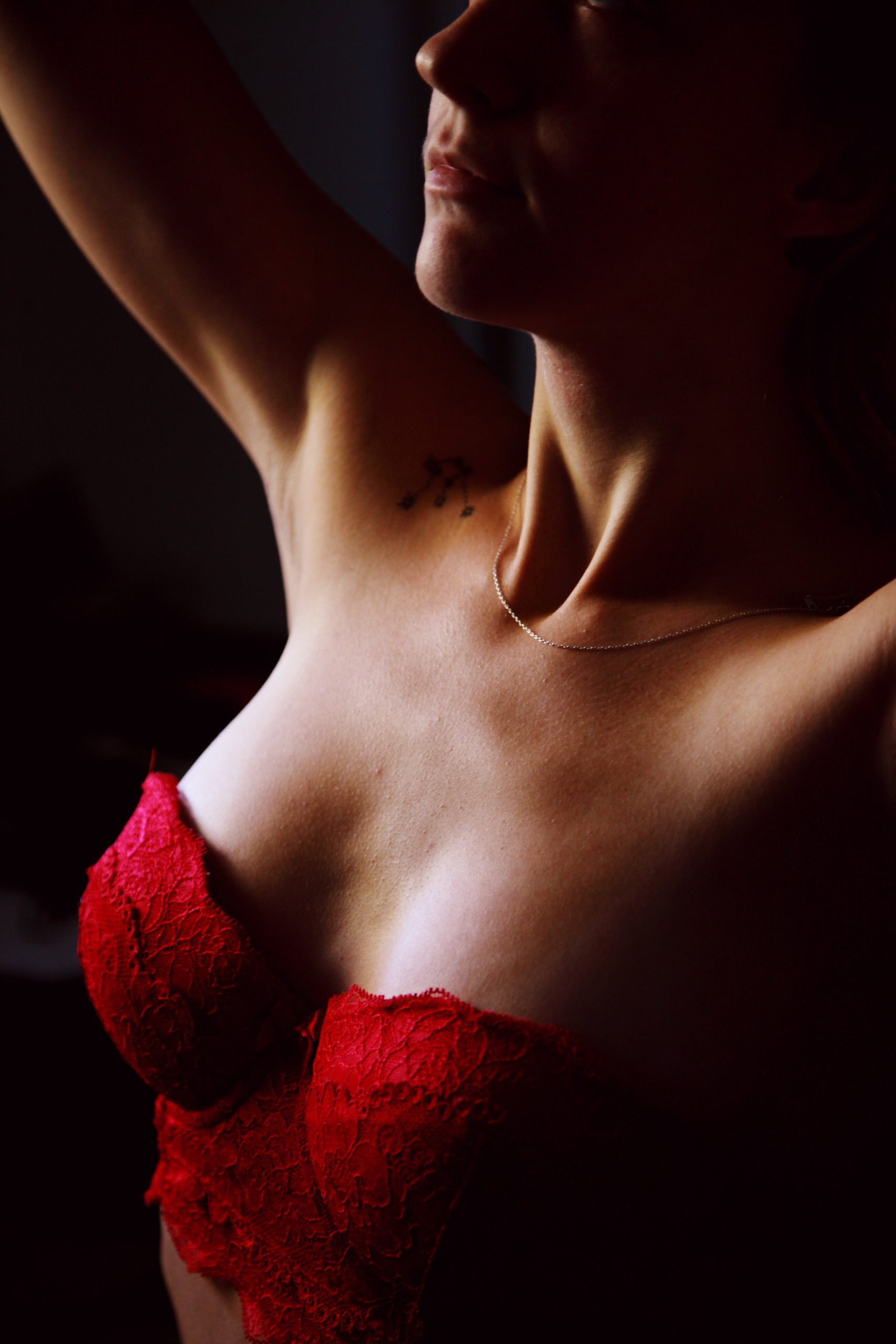 close-up-photo-of-woman-wearing-red-bralette-1548680