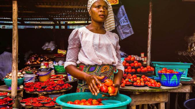 woman holding tomatoes