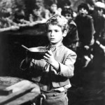 Image from the 1968 musical Oliver! in which Oliver Twist (played by Mark Lester) asks for more food.