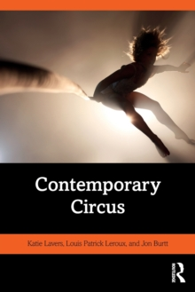 The book cover. The bottom half of the book cover is black with the title in white, and an orange stripe that has the authors names written in. The top half o the book cover is a photo. It's a hazy image of an aerialist, taken from the perspective of someone on the ground looking up the rope to see the performer dangling above them, silhouetted against a pearly light.