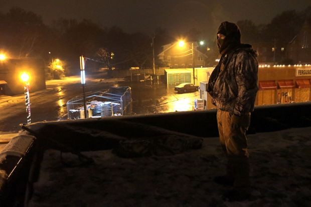 Missouri Oath Keeper on building roof, in Ferguson, protecting businesses.