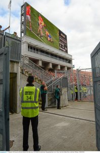 A volunteer steward keeps an eye on the final.    Picture credit: Ray McManus / SPORTSFILE