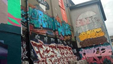 Various works of graffiti in the Tivoli theatre carpark, image by Hannah Lemass