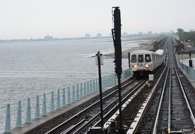 The first train to the Rockaways since October makes its way down brand new track.