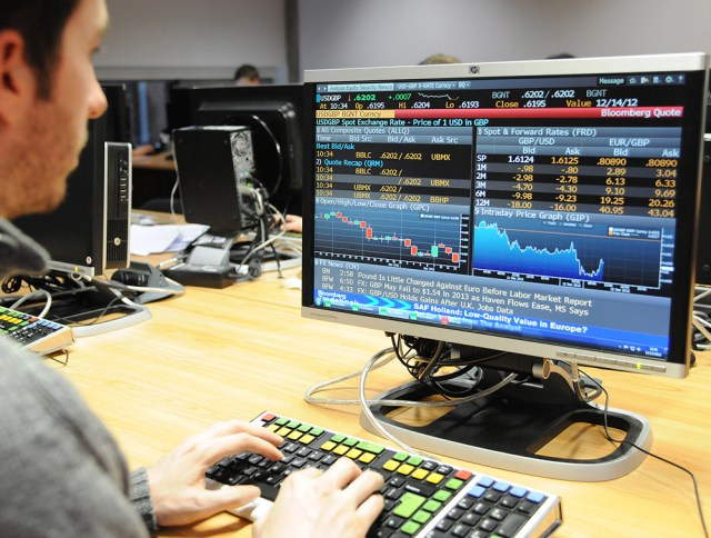 A finance student uses a Bloomberg terminal, which can carry environmental metrics. (Univ of Leicester)