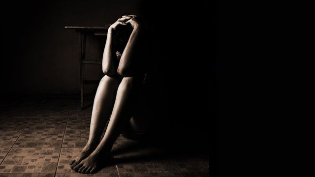 Sexual Abuse Woman sat on a floor