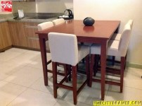 Dining table and chairs at Azalea Residences Baguio Family Suite