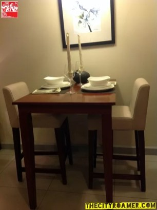 Dining table and chairs at Azalea Residences Baguio Romantic Suite