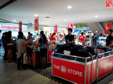 Stacks of Clothes during SM City Sta Mesa 3-Day Sale Aug 15 2014