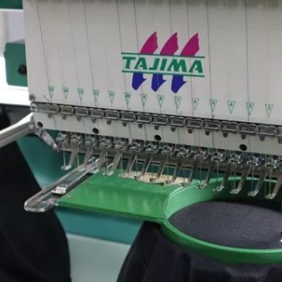 a machine doing the embroidery of Beldevere Vodka