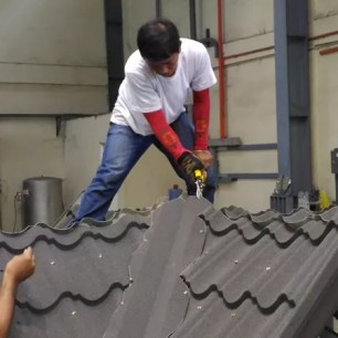 Metalink Stone Tile being trimmed during installation