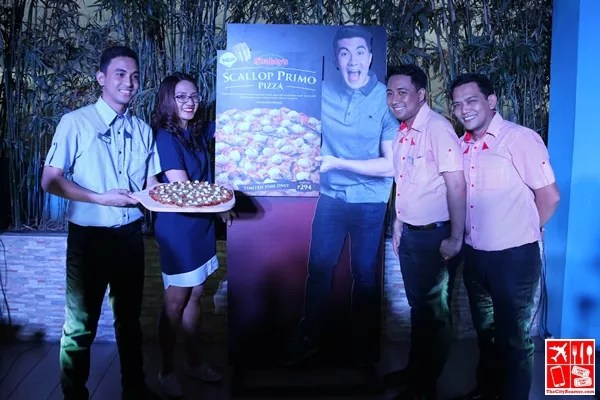 Shakey's Marketing Manager Ghena Austero with the Shakey's Team