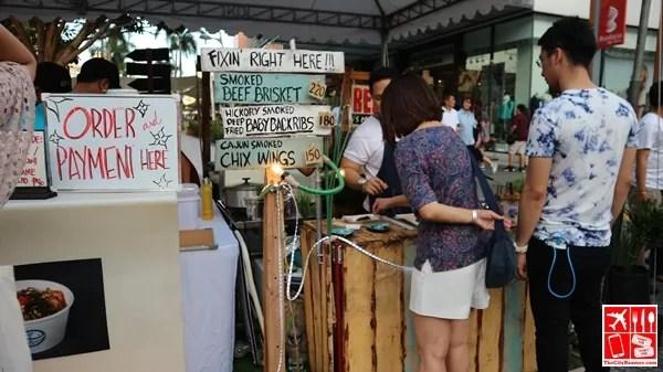 A food merchant at the Bonifacio High Street Food Festival with Bite Manila