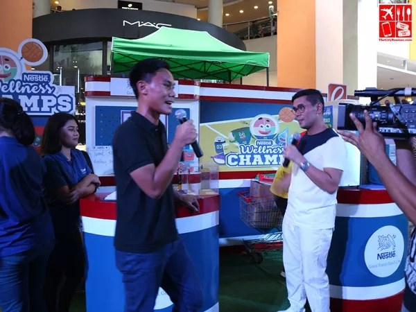 Tonipet Gaba drops by the Nestle booth at the Robinsons Supermarket Celebrate Wellness kick-off event
