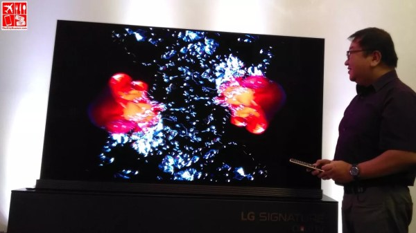 Yours truly marveling at the 77-inch LG Signature OLED TV