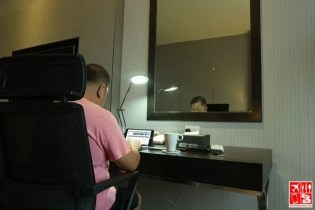 Doing some work at the office desk inside my room