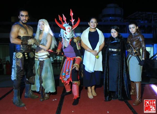 Le Charme Suites part-owner and managing director Ms Josephine Floresca with the cosplayers