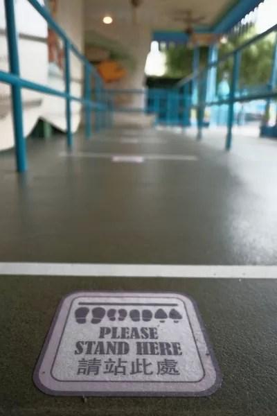Social distancing signage at Hongkong Disneyland