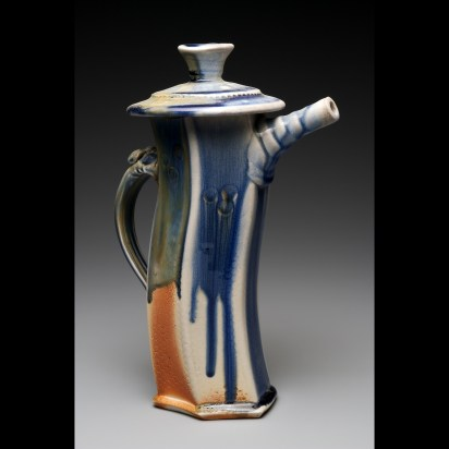 Extruded wood-fired teapot