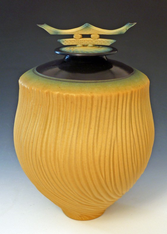 sculpted yellow urn
