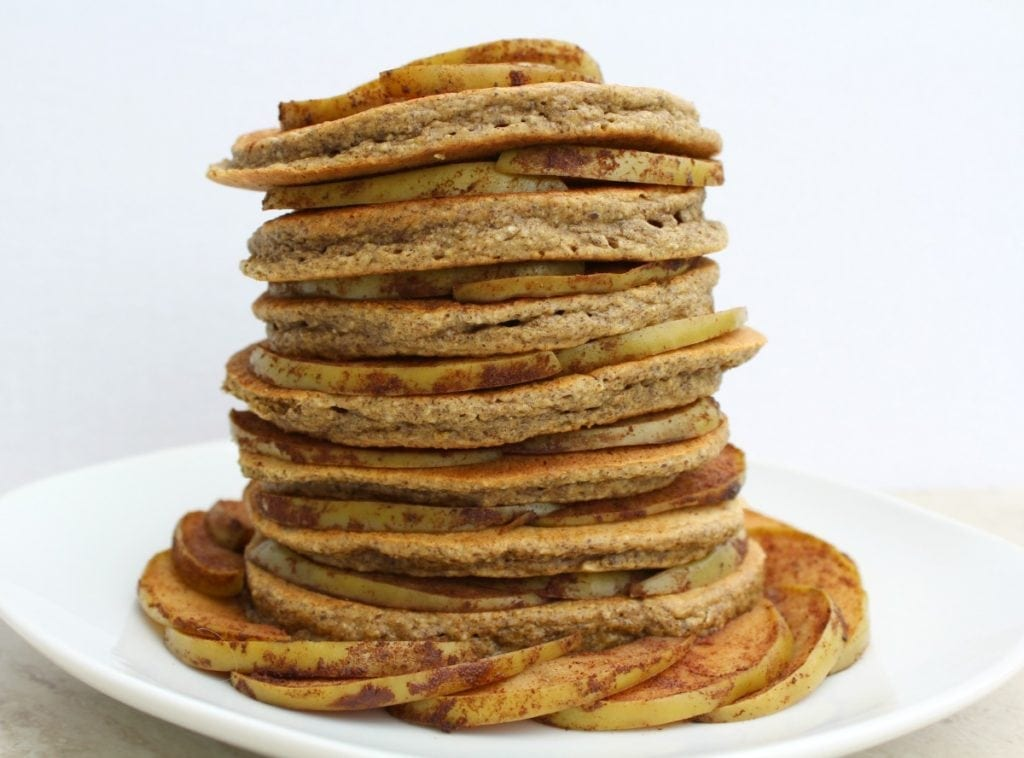 Healthy Apple Cinnamon Pancakes are the perfect gluten free breakfast or snack. Taste the flavors of fall year-round in these nutritious, simple pancakes!