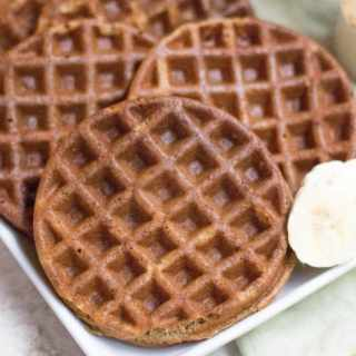 Close up photo of Healthy Blender Banana Bread Protein Waffles on a white plate.