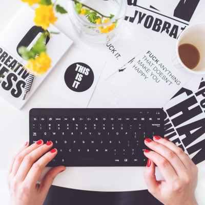 girl writing on a black keyboard