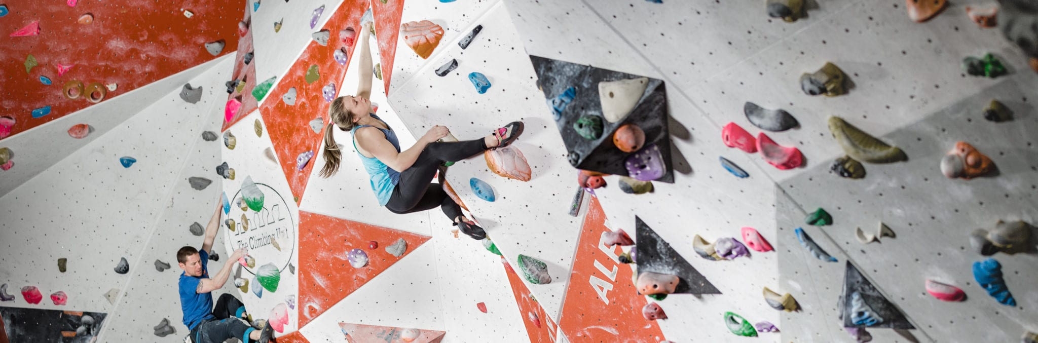 Two climbers climbing at the climbing wall
