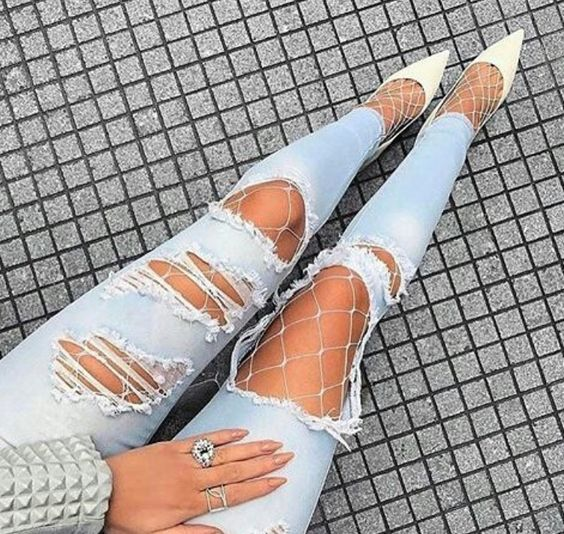 white fishnets ripped jeans and white stilettos