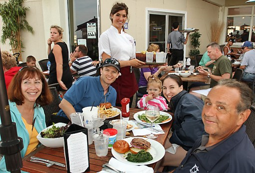 Enjoying a meal at McLoone's Asbury Grill on the boardwalk in Asbury Park were Karen Spiler, Asbury Park; Anthony Hadzimichalis, Aviva Hadzimichalis and Norell Hadzimichalis, all of Piscataway; Sheila Harver, server and Gabe Spiler, Asbury Park.