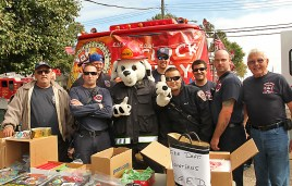 "Ocean Grove firefighters were at the Ocean Grove Fall Harvest Festival. Pictured are Dan Van Orden, Mike Olman, Ted Duda, Sparky, Ben Benfer, Randi Thorne, Chris Bedrosian, Ray Di Lello Jr. and Neil ""Silver Fox"" DenBraven."