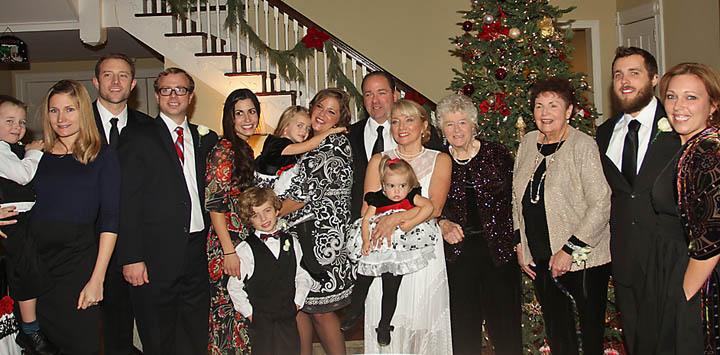 At Deal Country Club  Sat., Jan. 4 were newlyweds Joe Maggio, owner of Frank's Deli in Asbury Park, and Mary Hogan Maggio. With the Maggios were  (left to right)  Casey Hogan holding son LanDan, David and Matt Hogan, Aileen Hogan, Melinda Maggio holding Isabelle Hogan and Noah Hogan in front of them, the groom, Joe, the bride, Mary, holding Eliana, Eileen Walker, Maria Maggio, T.J. Maggio and his fiance Donna Bartlett. - Coaster photo by Mike Kearns