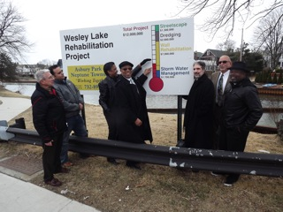 Neptune and Asbury Park officials update the funding chart for the Wesley Lake Rehabilitation Project on March 19. From left to right: Wesley Lake Commissioner James Henry, Asbury Park City Engineer Joseph Cunha, Wesley Lake Commissioner Sharon Davis, Neptune Mayor Michael Brantley, Project Engineer Peter Avakian, Neptune Business Administrator Vito Gadaleta and Wesley Lake Commissioner Pastor Paul Brown.