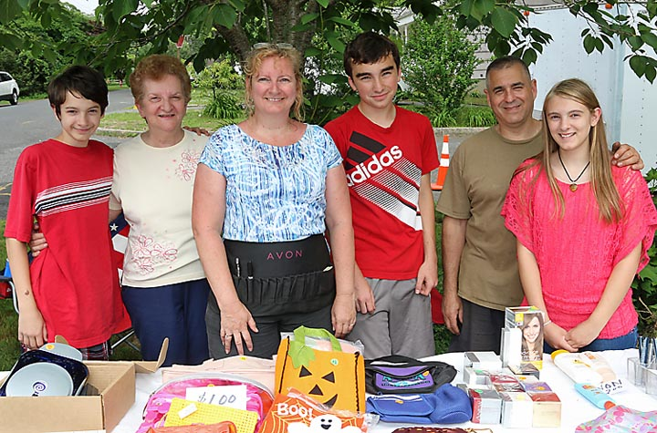 Checking out bargains at a garage sale in the Oakhurst section of Ocean Township were Thomas Viscuso, Marilyn Muller, Lynette Viscuso, Alex O'Hara, Tom Viscuso and Trysten Viscuso.