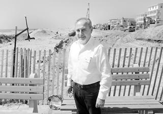 Coaster Photo: J.P. Gradone, chief operating officer for the Ocean Grove Camp Meeting Association, stands in front of the boardwalk replacement project now under way in the historic district.