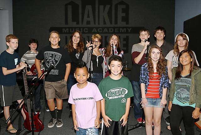 Liz Fackelman, an instructor at the Lake House Music Academy in Asbury Park, is pictured with her students during a rehearsal break.
